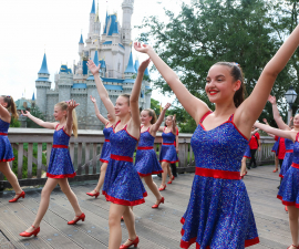Dancers performing down Main Street, U.S.A at Disney World