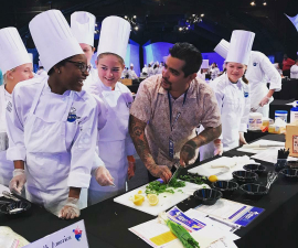 Aaron Sanchez with Student at Cook Around The World